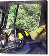 Firemen - Helmet Inside Cab Of Fire Truck Canvas Print by Susan Savad