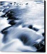 Flowing Stream Canvas Print by Les Cunliffe