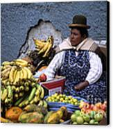 Fruit Seller Canvas Print by James Brunker