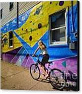 Girl Rides Bicycle Past Mural On The South Side Of Pittsburgh Canvas Print by Amy Cicconi
