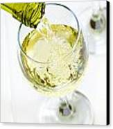 Glass Of White Wine Being Poured Canvas Print