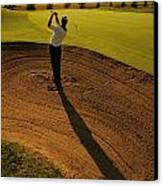 Golfer Taking A Swing From A Golf Bunker Canvas Print
