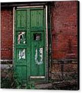 Green Door On Red Brick Wall Canvas Print by Amy Cicconi