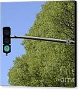 Green Traffic Light By Trees Canvas Print