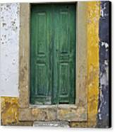 Green Wood Door With Hand Carved Stone Against A Texured Wall In The Medieval Village Of Obidos Canvas Print by David Letts