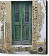 Green Wood Door With Hand Carved Stone In The Medieval Village Of Obidos Canvas Print