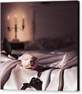 Handcuffs And A Rose On Bed Canvas Print
