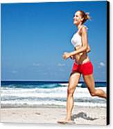 Healthy Woman Running On The Beach Canvas Print by Anna Om