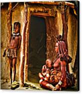 Himba Family By The Door Of Their Clay Hut Canvas Print by Paul W Sharpe Aka Wizard of Wonders