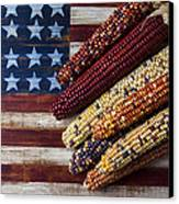 Indian Corn On American Flag Canvas Print by Garry Gay