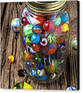 Jar Of Marbles With Shooter Canvas Print by Garry Gay