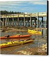 Kayaks By The Pier Canvas Print by Adam Jewell