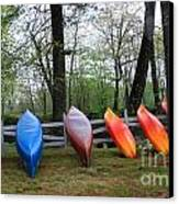 Kayaks Waiting Canvas Print by Michael Mooney