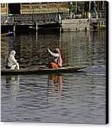 Ladies Plying A Small Boat In The Dal Lake In Srinagar - In Fron Canvas Print