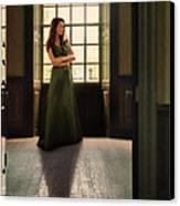 Lady In Green Gown By Window Canvas Print by Jill Battaglia