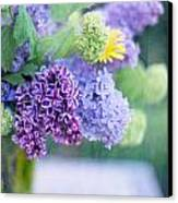 Lilacs On The Table Canvas Print by Rebecca Cozart
