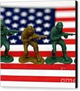 Line Of Toy Soldiers On American Flag Shallow Depth Of Field Canvas Print by Amy Cicconi
