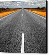 Long Straight Road With Gathering Storm Clouds Canvas Print by Colin and Linda McKie