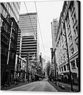 looking down granville street shopping area between the bay and pacific centre Vancouver BC Canada Canvas Print by Joe Fox