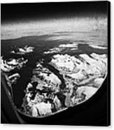 Looking Out Of Aircraft Window Over Snow Covered Fjords And Coastline Of Norway  Canvas Print by Joe Fox