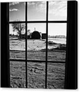 looking out through door window to snow covered scene in small rural village of Forget Canvas Print