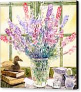 Lupins On Windowsill Canvas Print by Julia Rowntree
