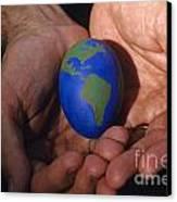 Man Holding Earth Egg Canvas Print by Jim Corwin