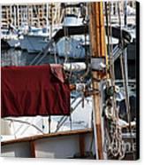 Maroon Sail  Canvas Print by John Rizzuto