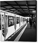 modern yellow u-bahn train sitting at station platform Berlin Germany Canvas Print
