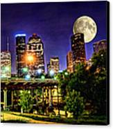 Moon Over Houston Canvas Print by Lester Phipps