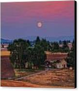 Moonrise At Sunset Canvas Print by Dan Quam