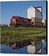 Train Reflection At Mortlach Saskatchewan Grain Elevator Canvas Print by Steve Boyko