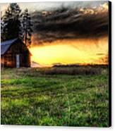 Mountain Sun Behind Barn Canvas Print by Derek Haller