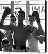 Muhammad Ali Raising Arms Canvas Print by Retro Images Archive