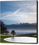 Naturally Formed Dew Pond In Countryside Landscape With Moody Sk Canvas Print