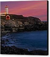 Nubble Lighthouse At Sunset Canvas Print by Susan Candelario