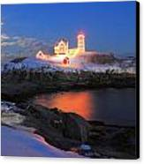 Nubble Lighthouse Holiday Lights And Winter Moon Canvas Print by John Burk