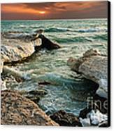 Ocean Waves Lapping At A Shoreline Canvas Print by Alexandr  Malyshev
