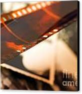 Old Film Strip And Photos Background Canvas Print by Michal Bednarek