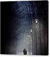 Old Man Walking On Snowy Winter Path At Night Canvas Print by Sandra Cunningham
