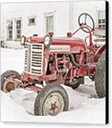 Old Red Tractor In The Snow Canvas Print