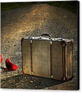 Old Suitcase With Red Shoes Left On Road Canvas Print by Sandra Cunningham
