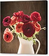 Orange And Red Ranunculus Flowers Canvas Print by Jan Bickerton
