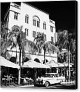 Orange Chevrolet Bel Air In The Cuban Style Outside The Edison Hotel Canvas Print by Joe Fox