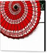 Paper Umbrella With Swirl Pattern On Fence Canvas Print by Amy Cicconi