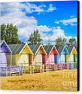 Pastel Beach Huts Canvas Print by Chris Thaxter