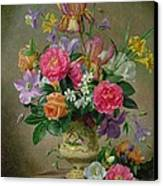 Peonies And Irises In A Ceramic Vase Canvas Print by Albert Williams