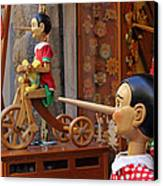 Pinocchio Inviting Tourists In Souvenirs Shop Canvas Print by Kiril Stanchev