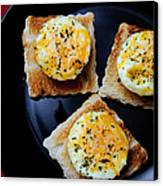 Poached Eggs On A Raft Canvas Print by Andee Design