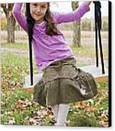 Portrait Of Young Girl On Swing Canvas Print by Vast Photography